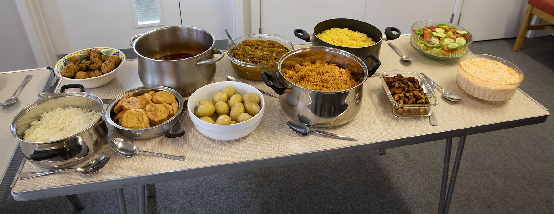 Table of food set out for fellowship meal